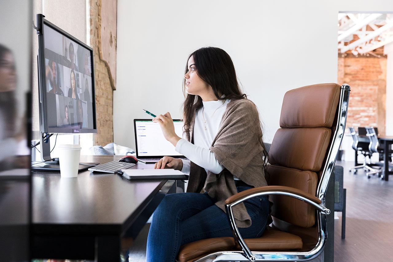 Small business owner following cloud based internet service provider webinar via her desktop