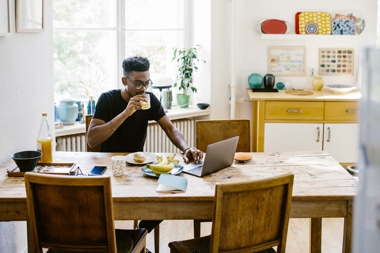 African American man working from home utilizing broadband internet remote technology